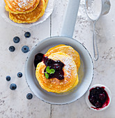 Blueberry pancakes with icing sugar