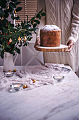Woman with Panettone Christmas cake