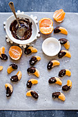 Mandarin segments dipped in salted chocolate