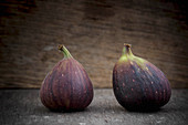 Two Figs on Wooden Background