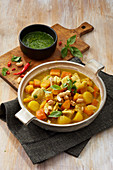 Pumpkin and potato stew with chicken and peanuts