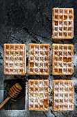 Waffles with icing sugard and honey