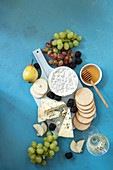 Cheese board with crackers and hones