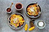 Homemade crepes topped with pomegranate, honey and maple syrup