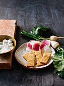 Radishes and turnips with yoghurt dip and cornmeal crackers