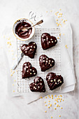 Gingerbread hearts with jam and chocolate glaze on a wire rack