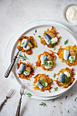 Potato latkes with pickled herring, apple sauce, sour cream and dill