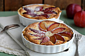 Baking of plum pie with almond frangipane, plumpie icing sugar