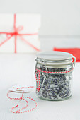 Homemade lavender scrub in a preserving jar as a gift