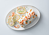 Spicy Swiss roll with salmon, prawns and avocado