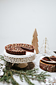 Chocolate cakes on a cake stands on a table decorated for Christmas