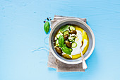 Healthy yogurt, olives, feta cheese, cucumber, olive oil and basil