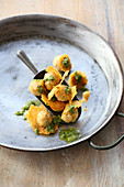 Parmesan dumplings with pesto
