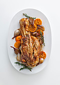 Veal knuckle with a champagne and orange sauce with clementines, shallots and lemon thyme