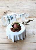 Damson ice cream dumpling in a chocolate coating