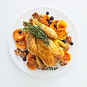 Roasted baby turkey with clementines, walnuts and blueberries