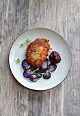 Oyster mushroom cordon bleu with purple potato salad and beetroot ketchup
