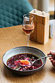 Beetroot soup and a glass of rosé wine