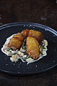 Mushroom ragout with hasselback potatoes