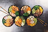 Six different poke bowls (seen from above)