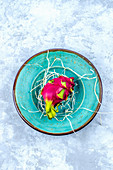 Dragon Fruit on a turquoise craft plate