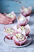 Chocolate cupcakes in pink tulip forms with butter cream