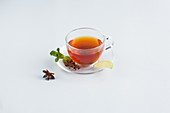 Tea in a glass cup against a white background