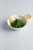 Algae salad in a bowl against a white surface (Japan)