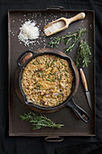 Risotto with spices and rosemary on a pan