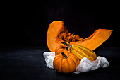 Pumpkin still life with a white cloth