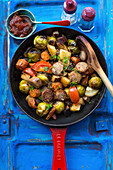 Sausages with brussels sprouts, sweet potatoes and tomatoes