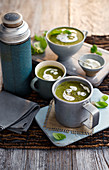 Spinach, broccoli and potato soup with sour cream