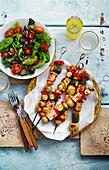 Tofu and vegetable kebabs with salad