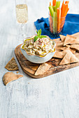 Eggplant dip with fresh vegetable sticks and flatbread