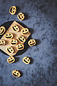 Halloween pumpkin shaped Jack O'Lantern sandwich cookies.