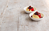 Quaking pudding (oven baked pudding, England) with berry compote