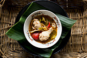 Tom Yum soup with chicken, tomatoes and lemongrass (Thailand)