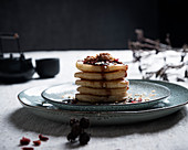 Vegan pancakes with blueberry syrup, walnuts and goji berries