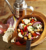 Vegetarian salad with paprika, chickpeas, onion and feta