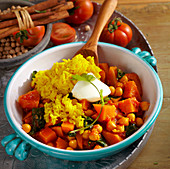 Sweet potato curry with chickpeas, cinnamon, tomato, spinach, garam masala, coriander, rice and natural yoghurt (India)