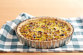 Roman lentil tart with shortcrust pastry, leeks, carrots, bacon, olives and egg