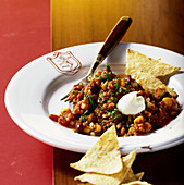 Vegetarian chili con carne made with green corn and tortilla chips