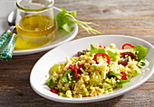 Millet salad with cheese and vegetables