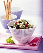 Bulgur salad with cucumber, olives, parsley, mint and lemon