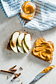 A sandwich with apple slices and sweet potato butter