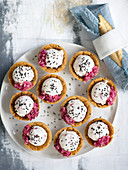 Tartlets with cheese balls and black sesame seeds