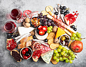 Italian gourmet antipasti mix of snacks and appetizers, cheese, meat, olives, bread, fruit, canapés and wine