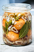 Pickled eggs with shallots in a jar (close up)