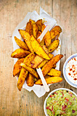 Potato wedges with an avocado dip and a sour cream dip
