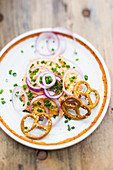 Obatzda with red onion rings and salt pretzels